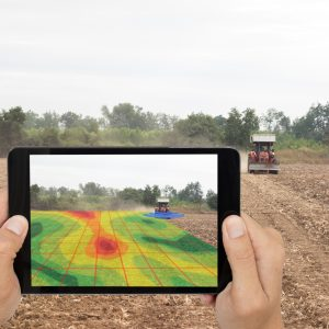 smart agriculture concept, farmer use tablet read infrared in tractor with high definition soil mapping while planting,conduct deep soil scan during a tillage pass include organic, ec,om,Nitrogen,seed