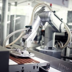 Chocolate production line in industrial factory. Automatic process in production line